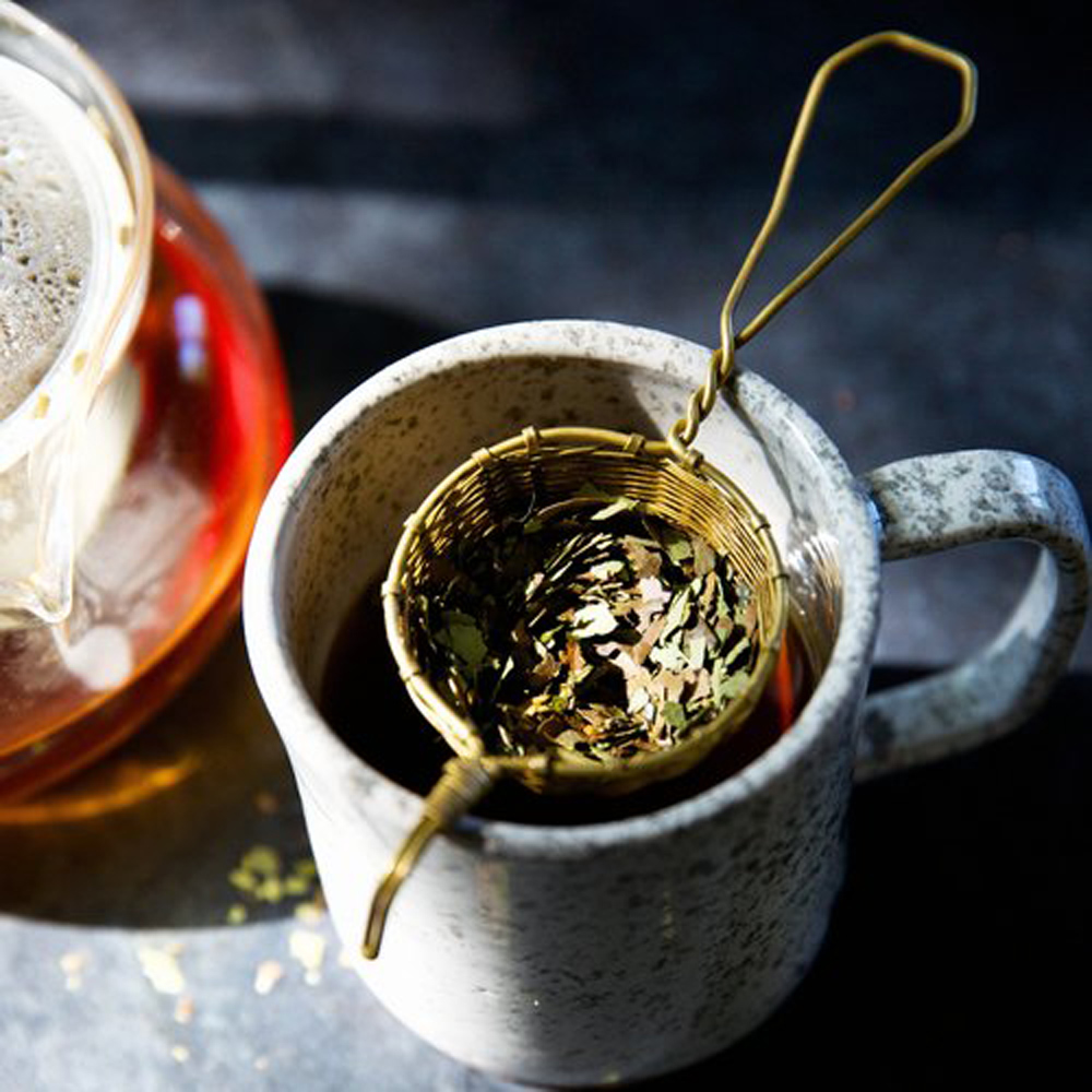Strain tea leaves or tea bag & re-steep!